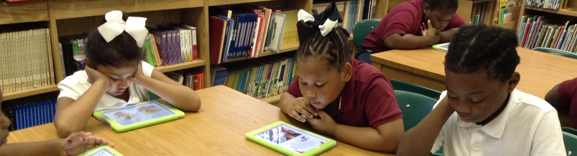 Second graders use tech tools in the library.